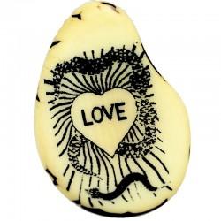 Gravure d'un Coeur sur une tranche de tagua